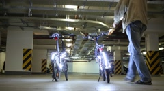 Man and woman sitting on illuminated diodes bikes Stock Footage