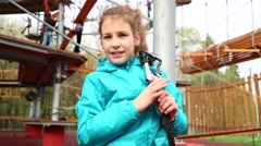 Girl with safety rope on her shoulder, smiling and waving hand Stock Footage