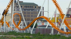 Roller Coaster Panning Shot at Coney Island New York During the Summer Stock Footage