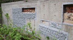 Panorama dilapidated wall with inscriptions in memory of workers Stock Footage
