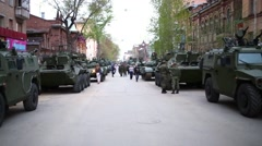 Street with military armored vehicles and soldiers on it during parade Stock Footage
