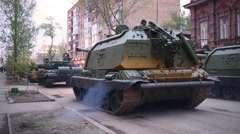 Tank with tanker bouncing off engine and soldier on streets of Samara Stock Footage