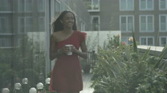 4K Portrait of smiling woman relaxing in apartment roof garden in the city Stock Footage