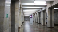 Empty subway station hall and leaving blue train with people Stock Footage