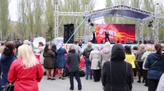 Crowd of people watched concert on stage at Victory Day Stock Footage