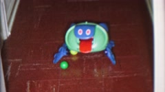 1965: Wacky robot toy chasin a ping pong ball sticking out tongue play. CEDAR Stock Footage