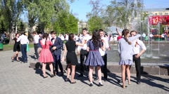 Teens dancing couples at fountain in park of Samara on celebration Stock Footage