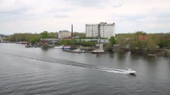 Speed boat floating on river Volga near jetty and ships. Stock Footage