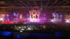 Light show in huge hall with central stage in Olympic Stadium Stock Footage