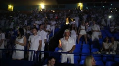 People standing or dancing among rows of seats at Olympic Stadium Stock Footage