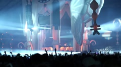 Central stage with DJ and inscription feel on screen and crowd Stock Footage