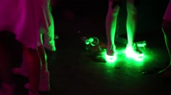 Legs with luminous diodes in dark on musical dance show. Stock Footage