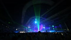 Green laser beams of light from central scene among people Stock Footage