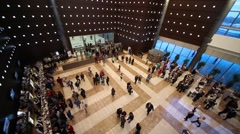 Spacious reception hall of concert hall with people and cafe. Stock Footage
