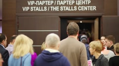People going, showing tickets, to VIP stalls in Crocus city hall Stock Footage
