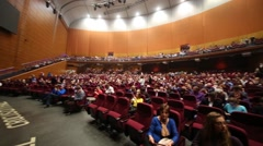 Panorama of concert hall with balcony, full of people Stock Footage