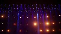 Flickering lights in spotlight beams above stage at music concert. Stock Footage