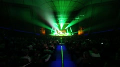 Illuminated scene with performing artists and full hall audience in dark. Stock Footage