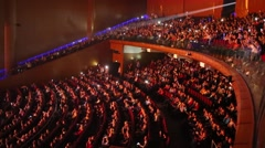 Concert Hall Crocus City with balcony full of people on show Stock Footage