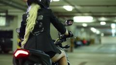 Woman in helmet and gloves on motorcycle pushing brake handle Stock Footage
