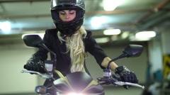 Woman on motorcycle helmet and gloves pressing brake handle. Stock Footage