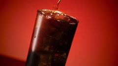 Cola Soda Splashing in Ice Star Filter Stock Footage