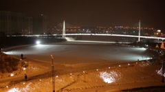 Pavshinsky floodplain and illuminated footbridge and wipers, remove snow Stock Footage
