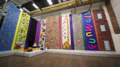 Panorama of empty room with climbing wall of funwalls club. Stock Footage
