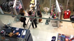 Women in store looking and choosing bags, hats and accessories. Stock Footage