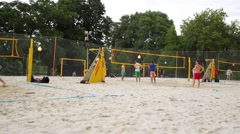 Panorama few sand volleyball courts on which people play Stock Footage