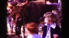 1967: Kids petting zoo hairy mule donkey horse like beast. SAN FRANCISCO, - stock footage