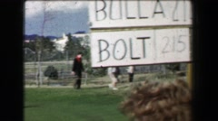 1969: Golf tournament Boros Bulla Bolt players scoreboard fairway walking. - stock footage