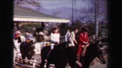 1967: Family riding horses white picket fence stables trotting course. AKRON, - stock footage