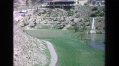 1968: Fancy golf course lined by large homes retention pond beauty. PALM Stock Footage