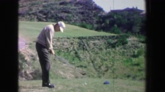 1968: Golfing man hits drive on fancy golf course into challenging fairway. PALM Stock Footage