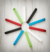 Various colorful bag clips arranged in the circle Stock Photos