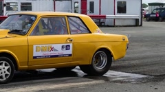 Drag racing driver warming up tyres at start of race, york raceway uk Stock Footage