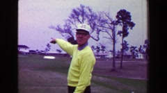 1968: Man golf hole-in-one shot pull ball out hole happy jumps excitedly. AMES, - stock footage