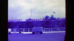 1969: Freeport International Airport business man carries overnight suit Stock Footage