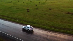 Flight over the cars. Wet road after rain. Aerial footage. Close up. - stock footage