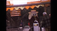 1970: Busch Gardens cartoon character furry mascot greeting visitors upon entry. Stock Footage