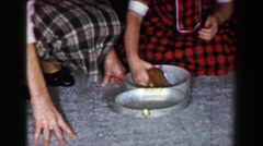 1958: Sisters create home for new hamster pet, cooking pot with lid. ST. LOUIS, - stock footage