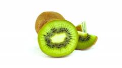 Kiwi fruit rotating on a white Stock Footage