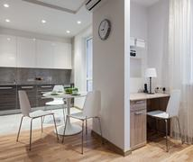 Interior of modern apartment in scandinavian style with kitchen and workplace - stock photo