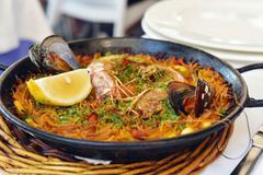 Spanish fideua, a typical noodles casserole Stock Photos