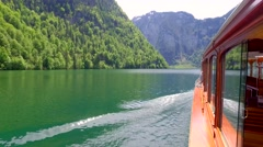 Flowing boat on the lake Konigssee in Germany, the Alps - stock footage