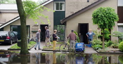 Extreme rain netherlands, people cleaning houses are having talk, 4K Stock Footage