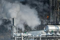 heavy industrial fog from exhaust tube in petrochemical and power industry es - stock photo