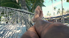 Man relaxing on hammock on beach, super slow motion 240fps Stock Footage