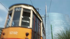 Milan, Italy - May 2016: Unicredit tower, low shot, tram passes by - stock footage